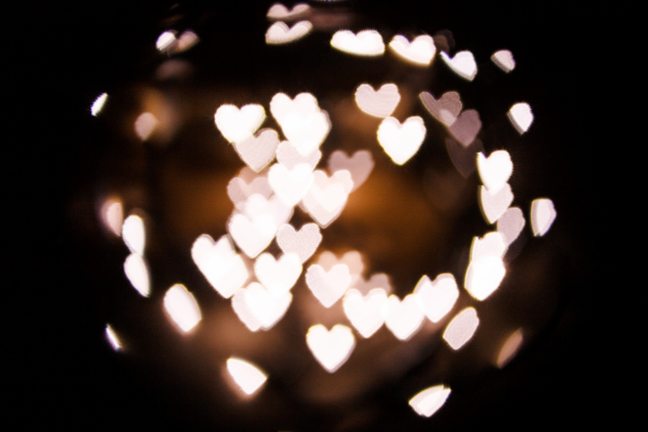 Bokeh of hearts in form of ball.